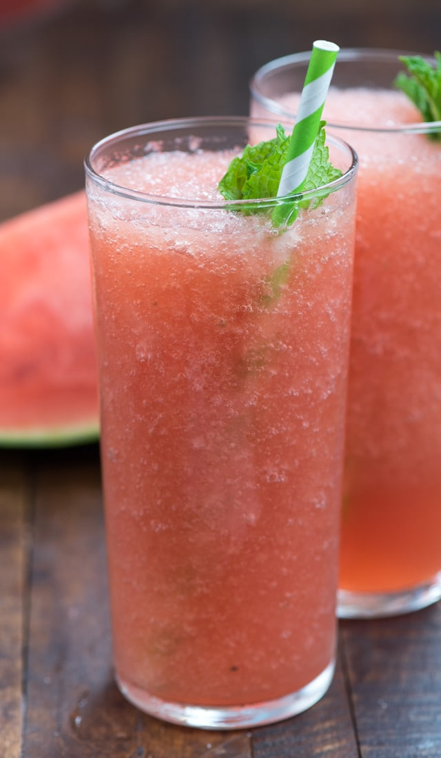 watermelon froze in tall glass with mint and straw