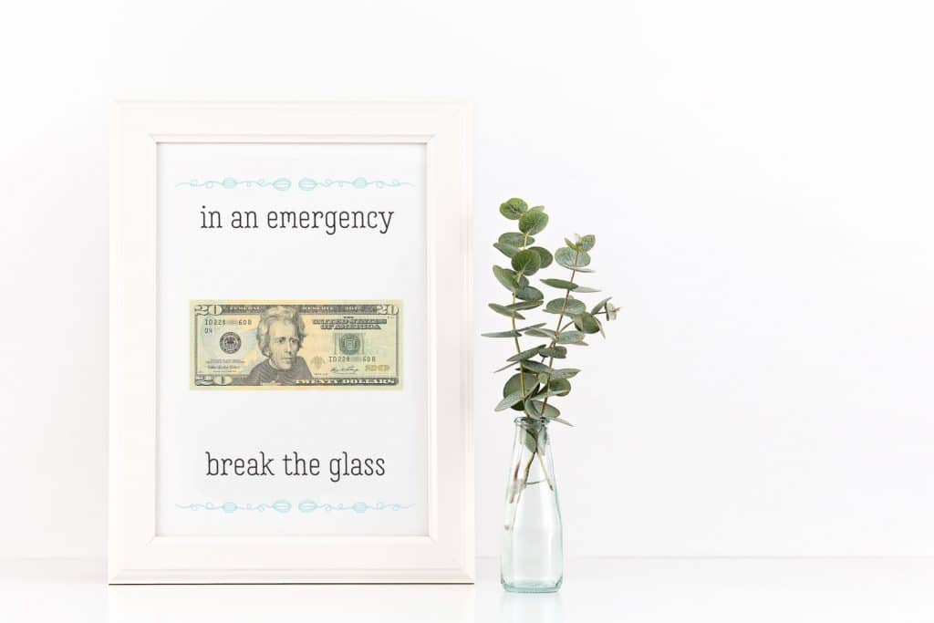 A framed 20 dollar bill with writing