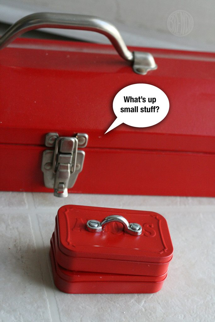 two miniature red tool boxes with a large red tool box in the background