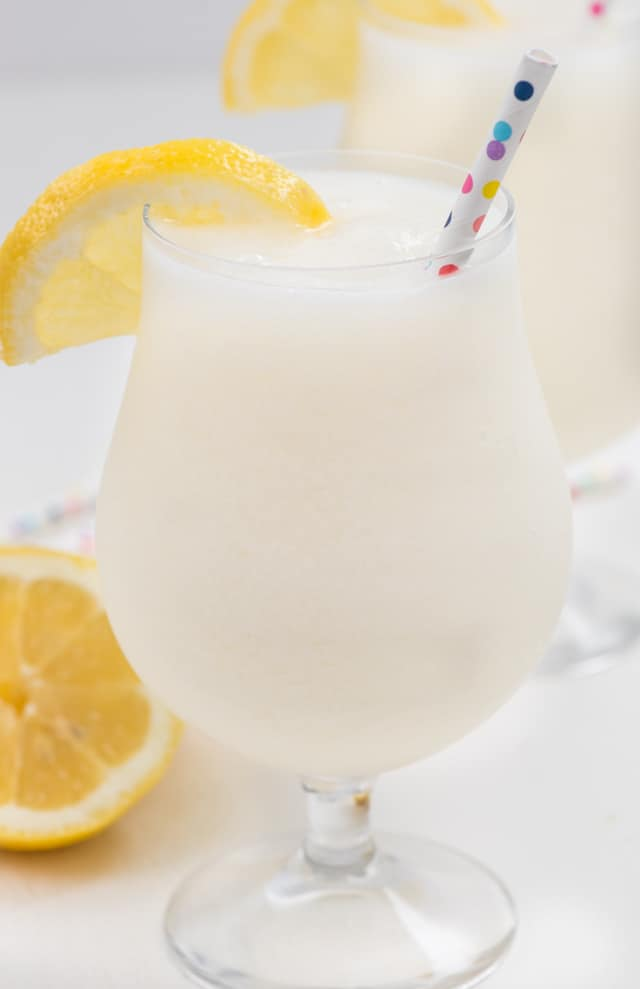 frozen lemonade in glass with straw