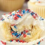 cut open fireworks cupcake with sprinkles inside