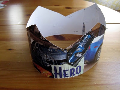 "a homemade crown that says ""hero"" on it"