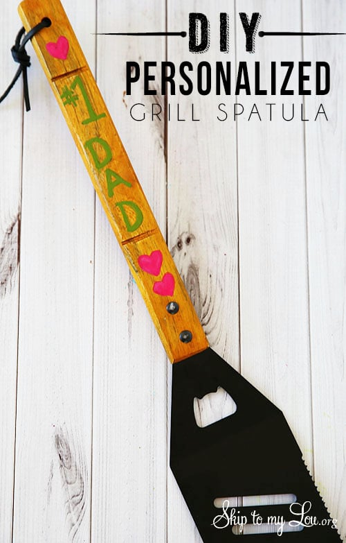 A personalized Father's day spatula with writing