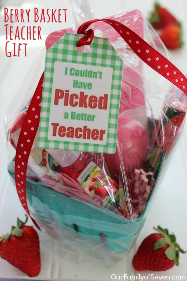 a basket filled with items for a teacher with a tag tied to it with red and white ribbon