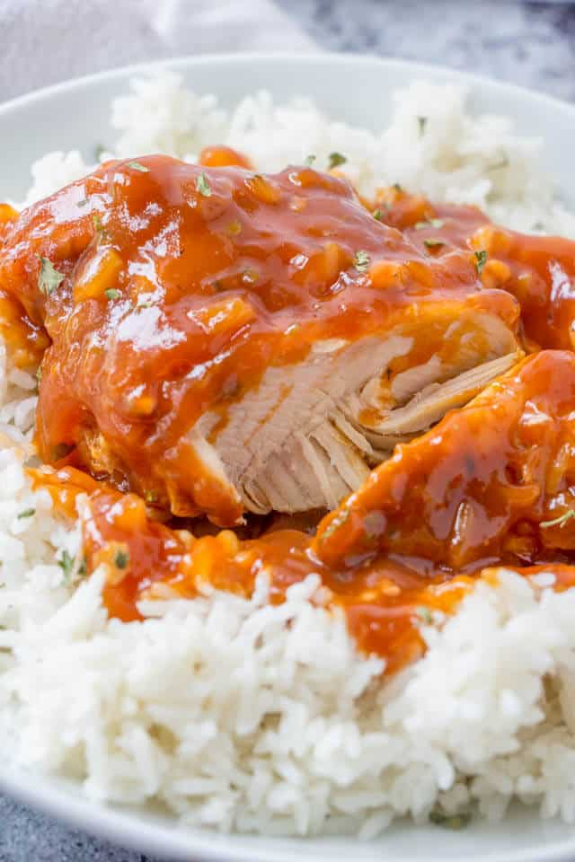 close up of instapot Hawaiian chicken on rice in a white bowl