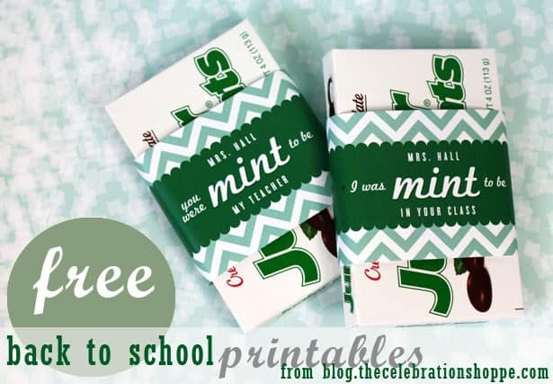 two junior mints boxes with signs wrapped around them