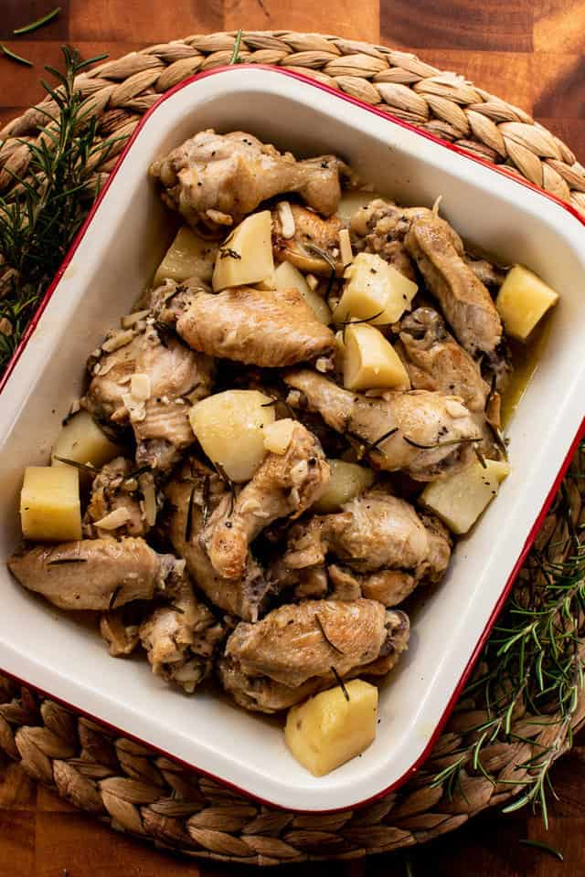 Chicken and Potatoes with rosemary in white pan
