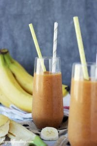 2 Pumpkin Banana Breakfast Smoothies in tall glasses with straws