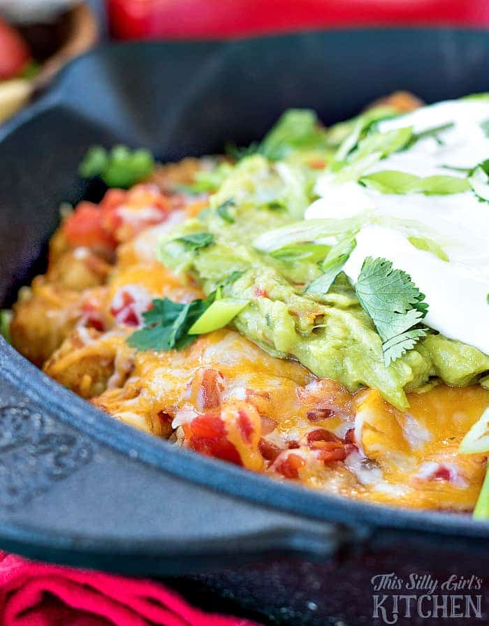 7 Layer Dip Totchos in a blue serving dish