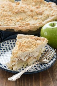 Crumb Apple Pie  on a blue and white plate with a fork
