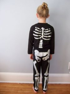 girl dressed in a skeleton costume