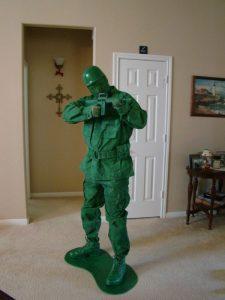 boy dressed like a toy Green army man
