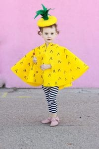girl dressed in a pineapple costume