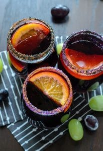 Halloween Sangria shot from above with three colorful drinks in clear glasses