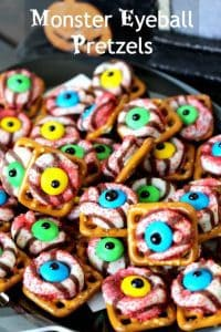 a bunch of Monster Eyeball Pretzels and the eyes are different colors