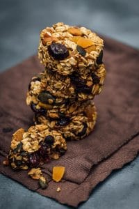 stack of Skinny Pumpkin Breakfast Cookies  on a brown cloth