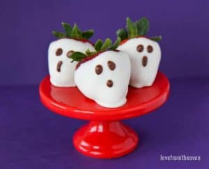 Strawberry Ghosts  on a red cake stand