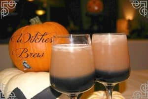 2 Witches Brew cocktails and a pumpkin with writing behind them