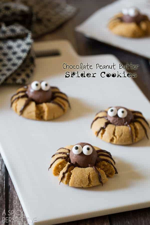 Chocolate Peanut Butter Spider Cookies on a white cutting board
