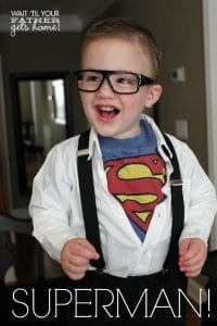 boy in a clark kent costume with the superman outfit underneath