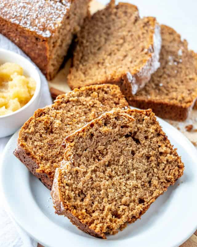 Applesauce Cake is an easy, old fashioned cake recipe made in a loaf pan and bakes up nice and golden! With simple ingredients that come together in minutes this cake is a perfect Fall dessert recipe.