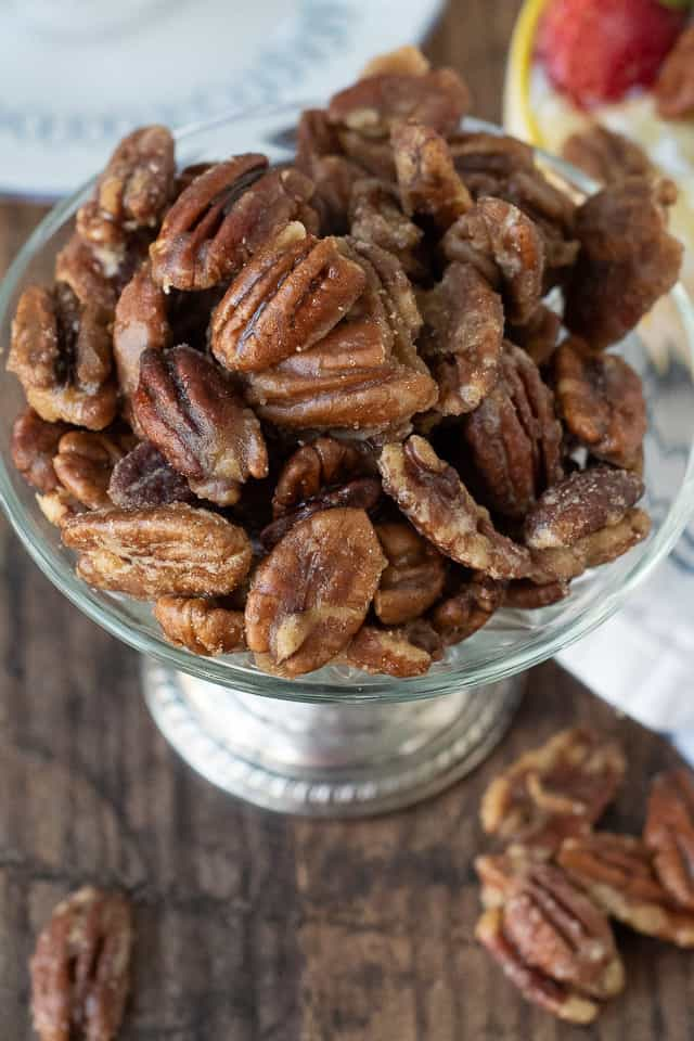 a close up overhead shot of candied nuts in a small pedestal bowl