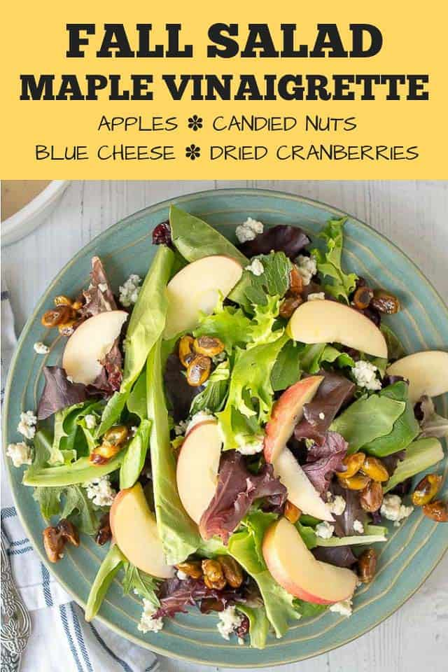 Fall salad with Maple Vinaigrette combines fresh greens, candied nuts, crisp apples, dried cranberries, and tangy blue cheese all tossed together in a deliciously easy dressing. #healthy #dressing #forparties #easy #thanksgiving #apple