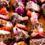 Steak kabobs with vegetables on a cutting board