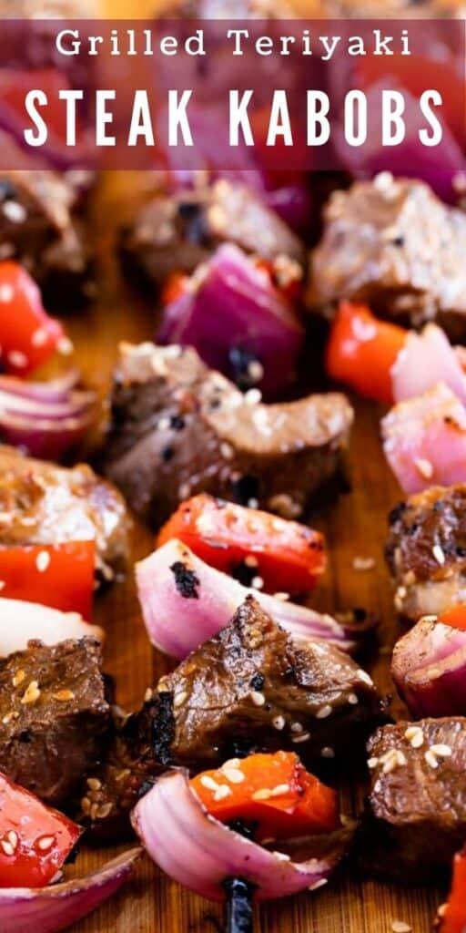 Steak kabobs on a cutting board