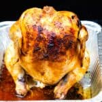 Beer can chicken in an aluminum pan