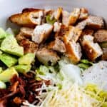 Closeup photo of caesar salad ingredients unmixed in a white bowl