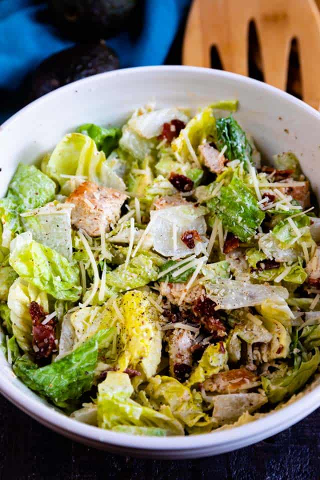Overhead shot of caesar salad in a white bowl
