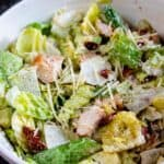 Close up shot of caesar salad in a white bowl