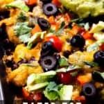 Tater tot nachos on sheet pan with guacamole