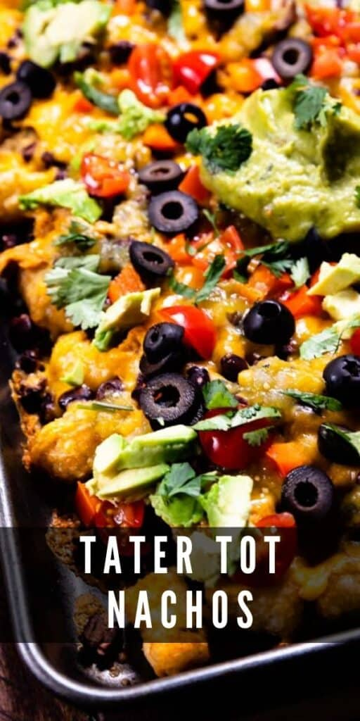 Tater tot nachos on sheet pan with guacamole
