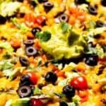 Sheet pan of tater tot nachos with avocado