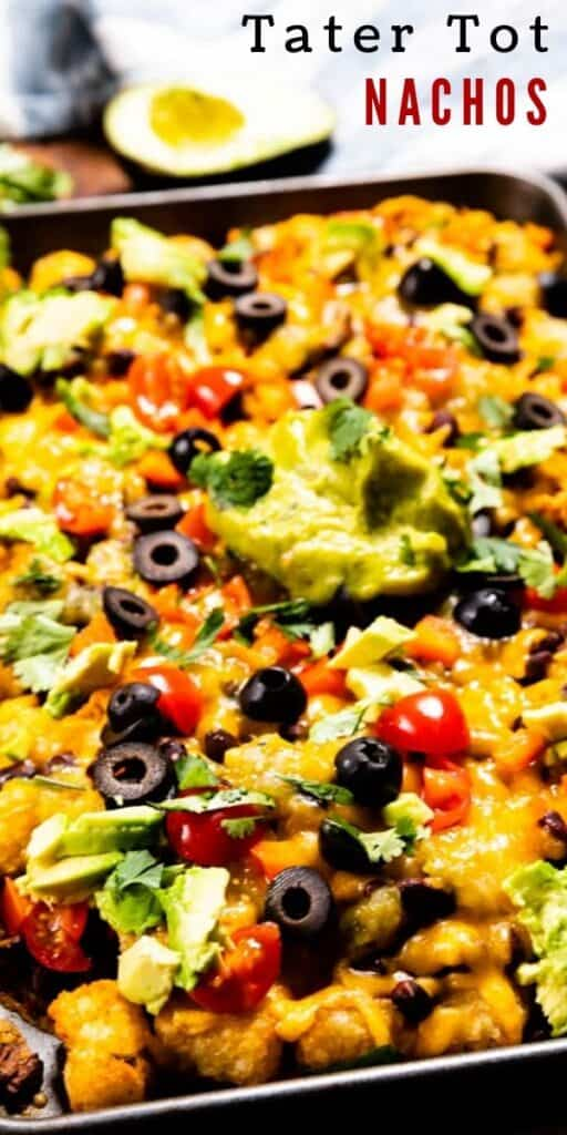 Sheet pan of tater tot nachos with avocado