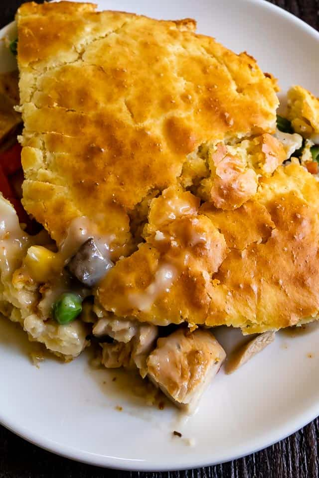Overhead shot of chicken pot pie on a white plate