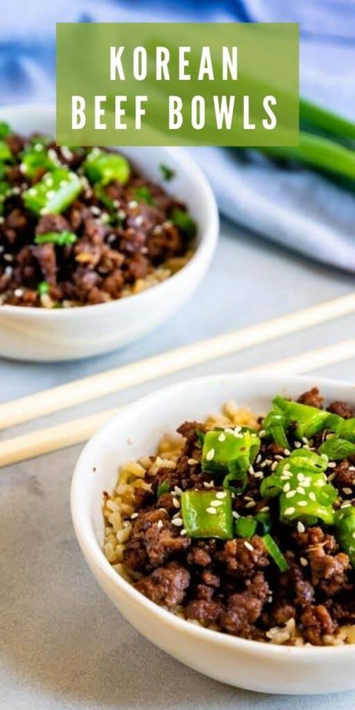 Korean beef bowls in white bowls with chopsticks in between with recipe title on top