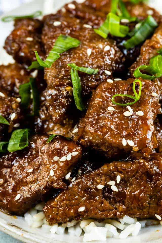 Close up shot of mongolian beef on rice