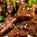 Mongolian beef with green onions on top of white rice