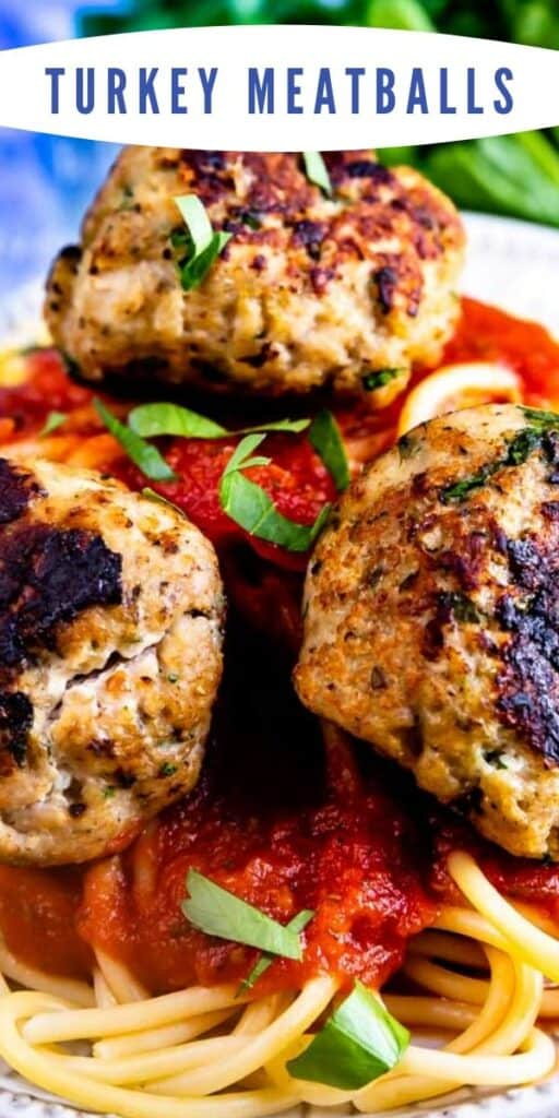 Overhead shot of turkey meatballs on top of pasta on a white plate with recipe title on top of image