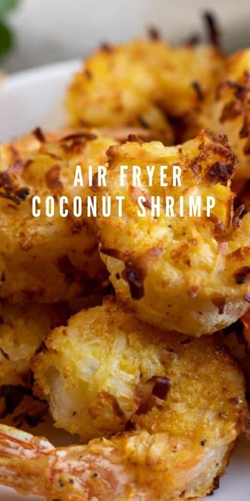 Close up of air fryer coconut shrimp on a white plate with recipe title on image