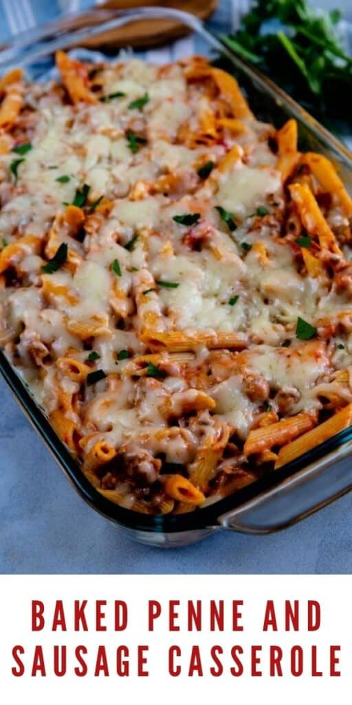 Overhead shot of baked penne and sausage casserole in clear casserole dish