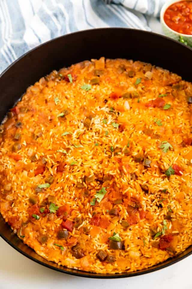 Overhead shot of spanish rice in an iron skillet