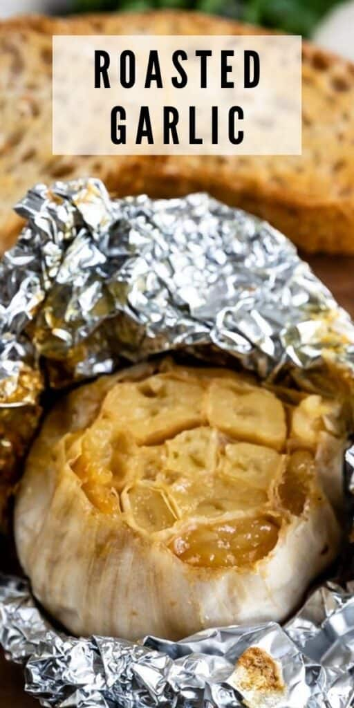 Close up of roasted garlic in foil wrap with recipe title on top of image