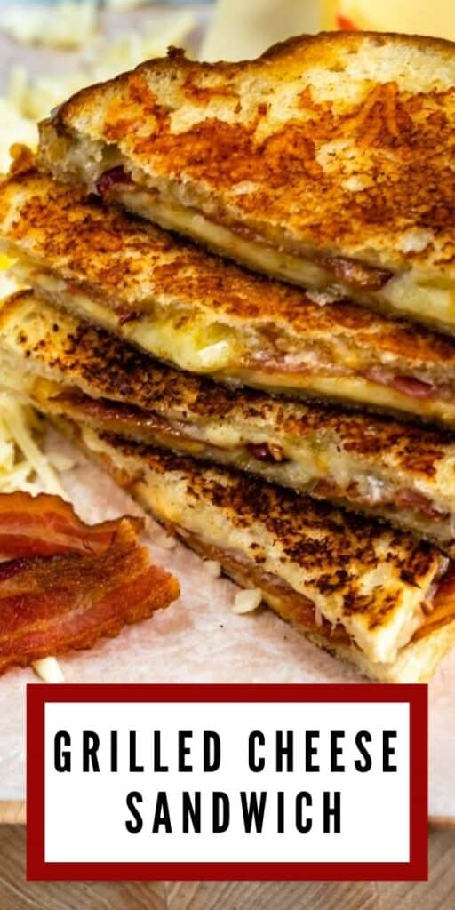 Grilled cheese sandwiches cut in half and stacked on top of eachother surrounded by cheese and bacon with recipe title on bottom of image