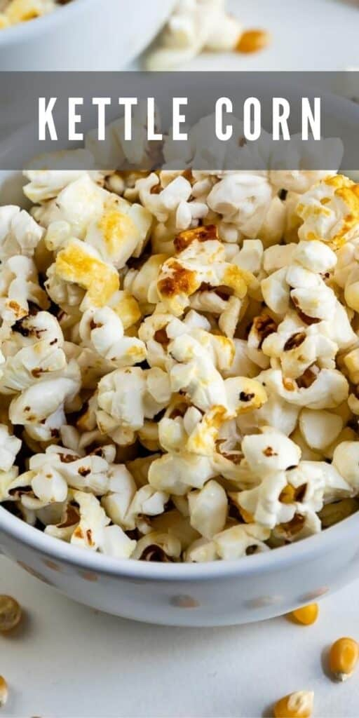 Close up overhead shot of kettle corn in a bowl with recipe title on top of image