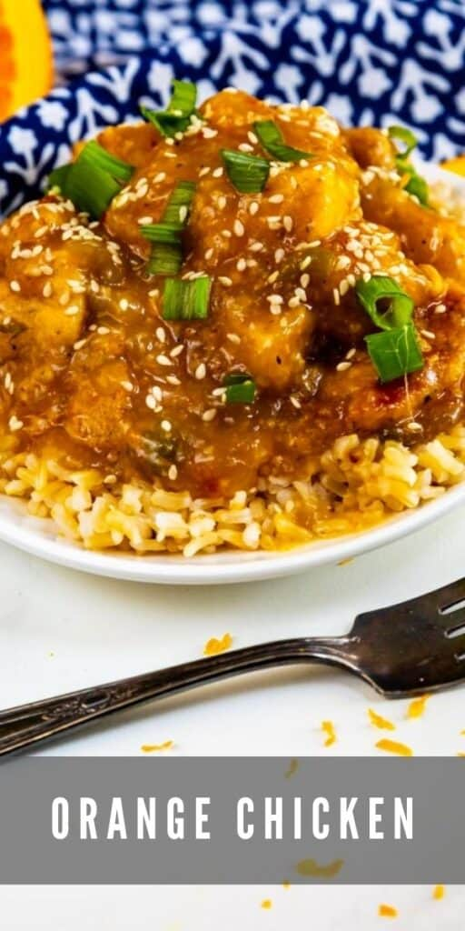 Plate of orange chicken over rice with a fork next to it and recipe title on bottom of image