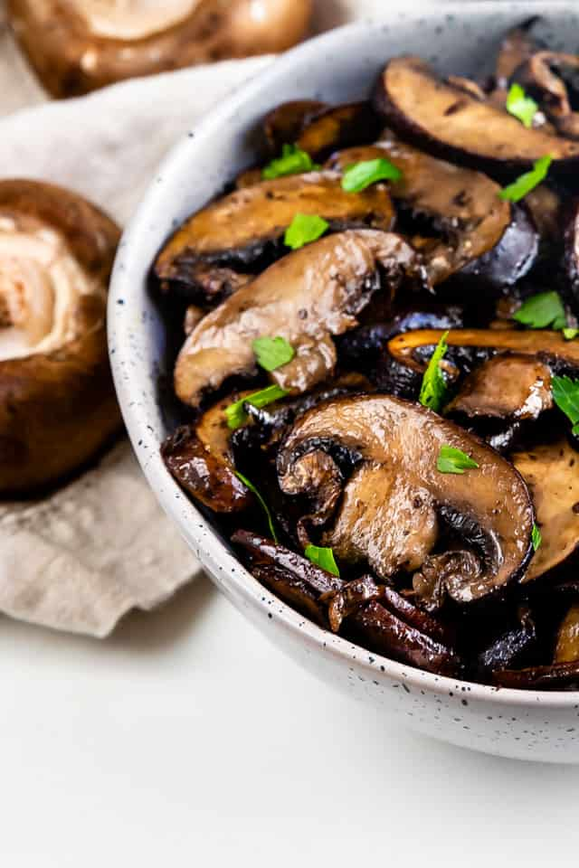 Close up shot of bowl of oven seared mushrooms